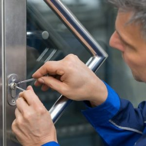 locksmith picking door lock